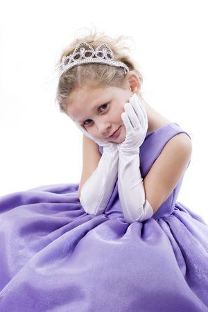 Una linda niña vestida como una princesa con tiara  Foto de archivo