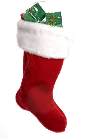 Bright red Christmas stocking with presents over white background