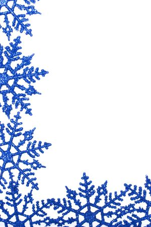 winterly: Winterly background with bright blue snowflakes isolated on white background