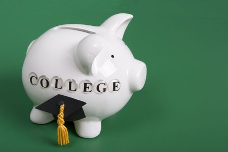college fund savings: Saving for college - piggy bank with diploma cap