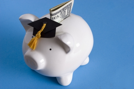 scholarship: Piggy bank with a graduation cap with dollar bill Stock Photo