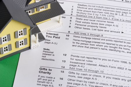 deduction: federal income tax form with colorful yellow house - mortgage interest deduction