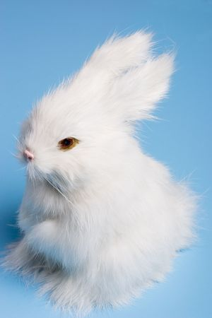 white cute easter bunny on a bright blue background