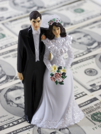 financial agreement: A bride and groom on a money background Stock Photo