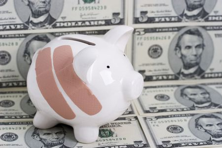 Piggy bank with bandages on money background of five dollar bills Stock Photo - 784686