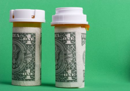 Prescription pill bottles wrapped in one dollar bills Stock Photo - 793791