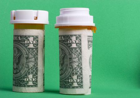 Prescription pill bottles wrapped in one dollar bills Stock Photo - 793791