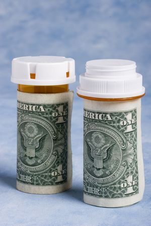 Prescription pill bottles wrapped in one dollar bills Stock Photo - 793794