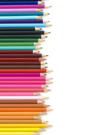 arrange: Color  pencils in arrange in color wheel colors on white background