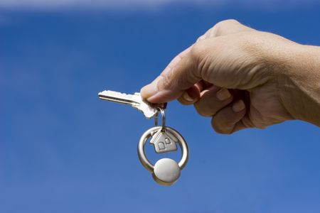 Woman holding a key for a house on a keychain Stock Photo - 793812