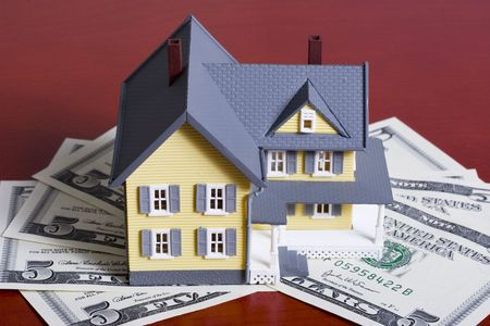 in escrow: Two-story house with five dollar bills background Stock Photo