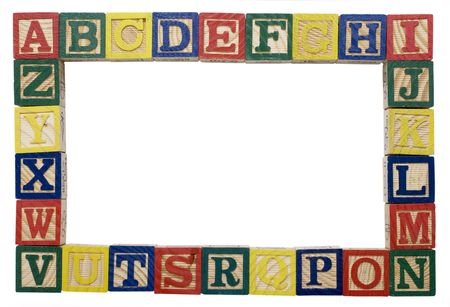 wooden blocks of the alphabet in a frame to be used as a background photo