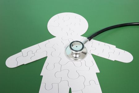A puzzle in shape of a human with a stethoscope Stock Photo