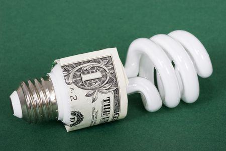 florescent light: An energy efficient light bulb with one dollar bill Stock Photo