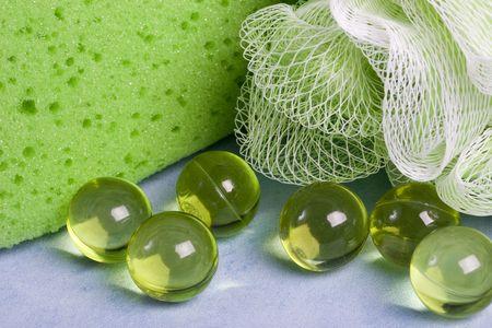 scrubber: Spa beauty kit - sponge, puff scrubber and bath gel bubbles Stock Photo