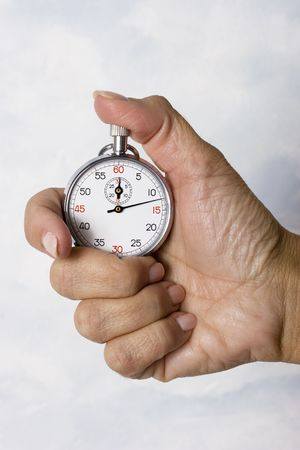 Woman holding a stopwatch that is running photo