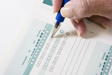 Filling out a business survey with a pen Stock Photo - 843135