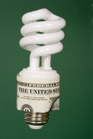 An energy efficient light bulb surrounded by dollar bill Stock Photo - 846608