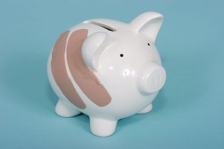 Piggy bank with two band aids Stock Photo - 846602