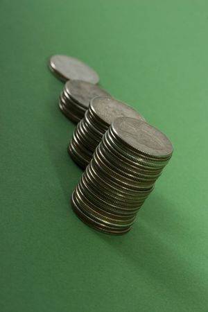 A row on coins with increasing value photo