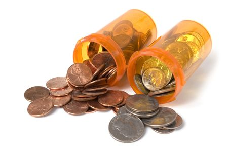 Pill bottles spilling out money quarters, dimes and pennies Stock Photo - 1262722