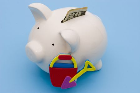 bucket of money: A piggy bank for the saving of a vacation