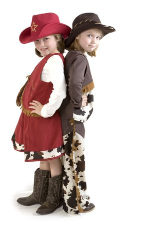 kids dress: Happy young girls with a cowboy hat and cowboy boots