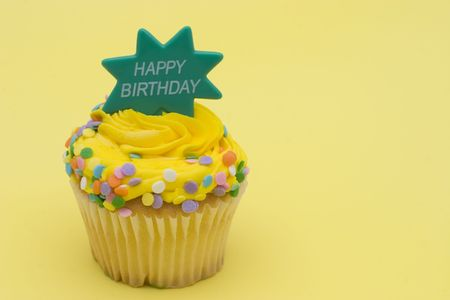 Delight colored cupcake on colorful background