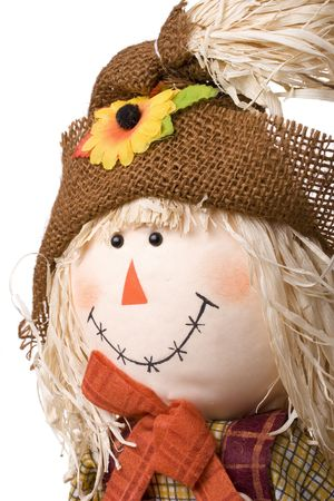 Cute  girl scarecrow isolated on a white background