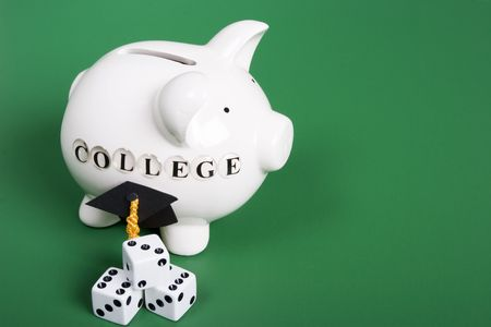 college fund savings: Saving for college - piggy bank with grad cap and dice