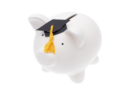 college fund savings: Piggy bank with a graduation cap isolated on white background Stock Photo