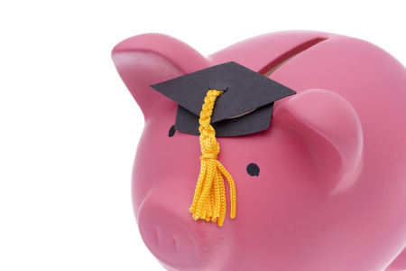 grant: Piggy bank with a graduation cap isolated on white background Stock Photo