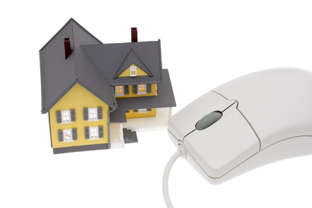 downpayment: A bright yellow house with a computer mouse