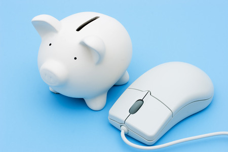 A piggy bank with a mouse on a light blue background photo