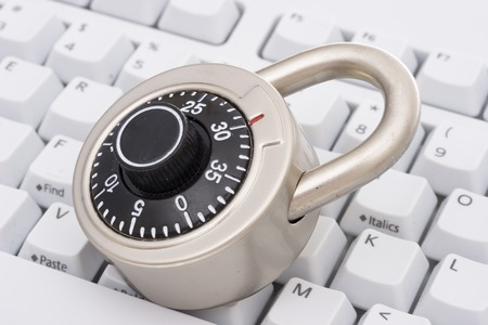 A black combination lock on a keyboard Stock Photo - 1656539