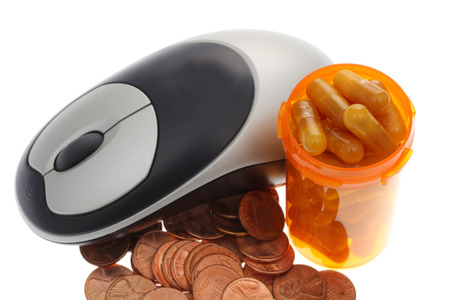 technology transaction: Mouse with a pills and pill bottle and pennies - computerized healthcare and costs