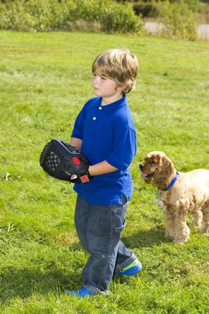Young boy playing catch with dog Stock Photo - 1798267