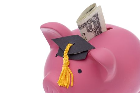 white interest rate: Folded dollar bill being inserted into bank wearing graduation hat