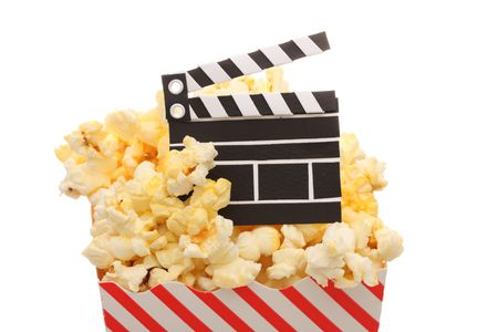 feature films: A box of popcorn and a movie slate Stock Photo