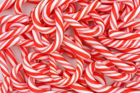 A Christmas achtergrond van mini snoep wandelstokken Stockfoto