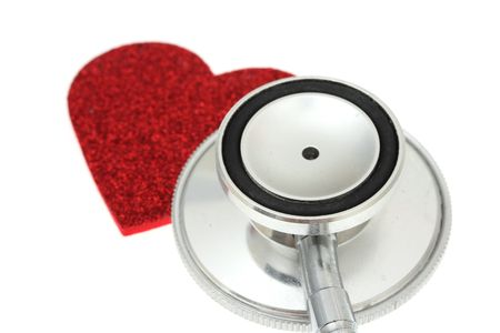 murmur: Heart cut out with stethoscope isolated on a white background Stock Photo
