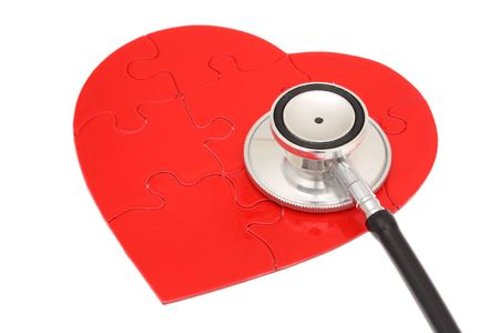 Red heart shape puzzle with stethoscope photo