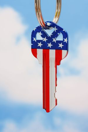 House key with American flag with a sky background Stock Photo