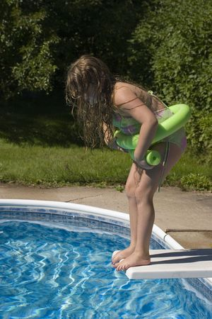 jump suit: Child about to jump from diving board Stock Photo
