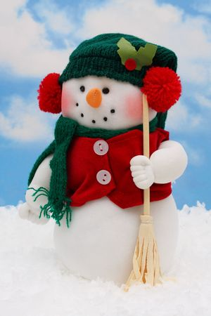Snowman in the snow on sky background Stock Photo