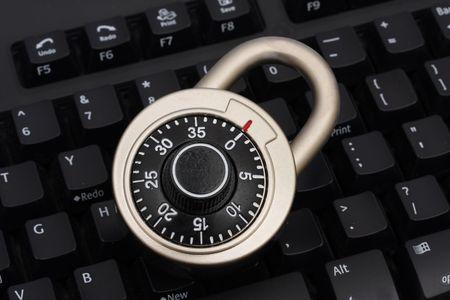 Combination lock on keyboard Stock Photo - 1859605