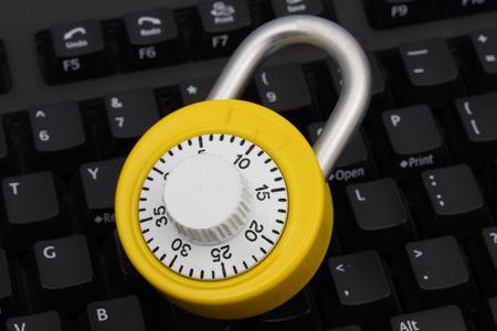 Bright yellow combination lock on keyboard Stock Photo - 1859596