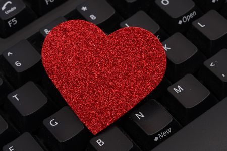 Close up of heart cut out on keyboard photo