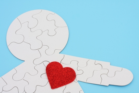 Heart cut out on puzzle of body Stock Photo - 1859599