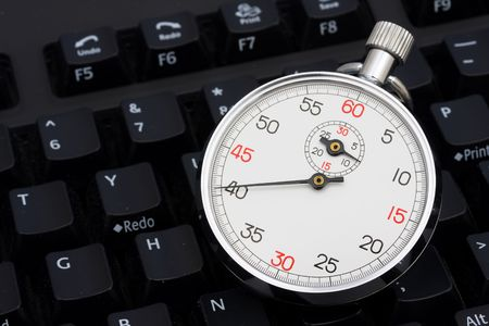 Close up of stopwatch on a keyboard